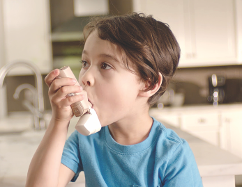 Step 2 image of child using QVAR RediHaler®, an inhaler for kids 4 yrs. and older